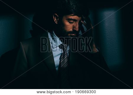 Businessman Or Political Prisoner In Dark Cell. Concept Of White Collar Crime