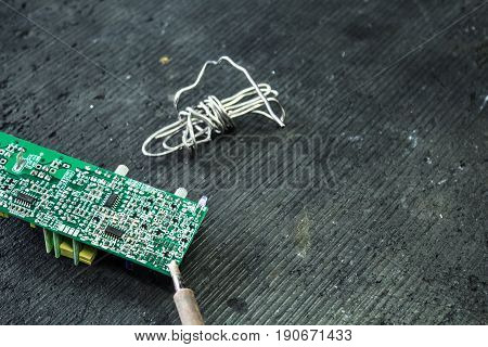 Soldering Iron Printed Circuit Board And Solder On A Dark Background