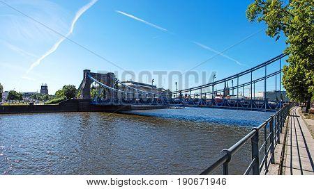 Wroclaw most famous buildings - Grunwaldzki Bridge on Odra river and Urzad wojewodski in the background