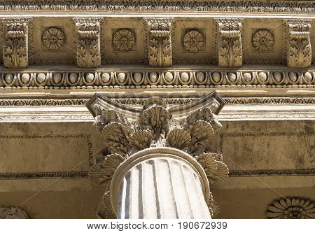 The view from below for the capitals and entablature of the Corinthian order of the Kazan Cathedral in St. Petersburg.