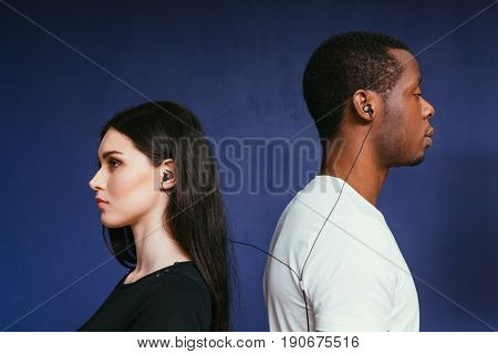 Man Woman Music Earphones International Couple Listen Lyrics Serious Thoughtful Unity Togetherness Concept