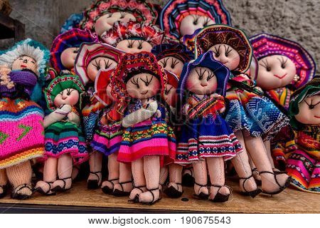 Peruvian traditional wares and dolls for sale in Ollantaytambo Peru