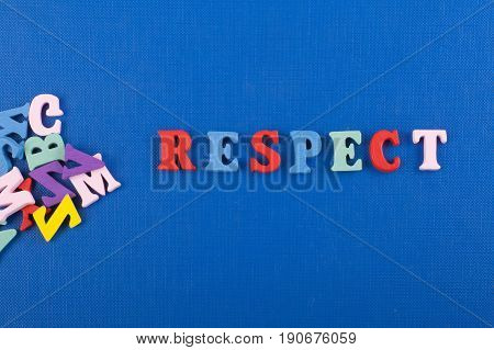 RESPECT word on blue background composed from colorful abc alphabet block wooden letters, copy space for ad text. Learning english concept