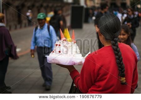 Quito Ecuador - January 29 2014: Local woman selling ice cream in a street of the city of Quito in Ecuador