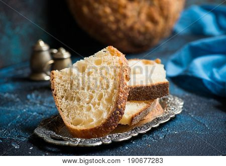Homemade sourdough bread. Sliced wheat sourdough on rustic background selective focus