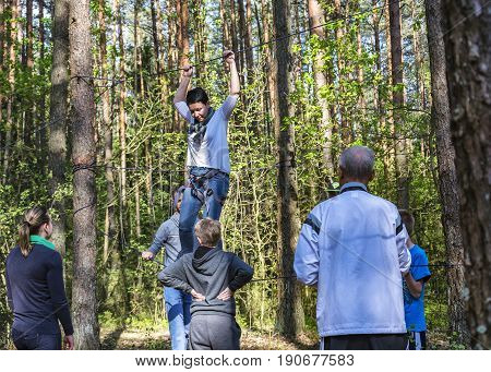Belarus, Minsk - 05/13/2016: On a tight rope a woman with insurance