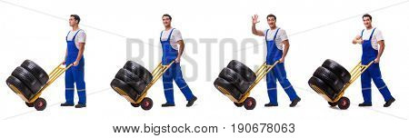 Tyre repairman with trolley isolated on white