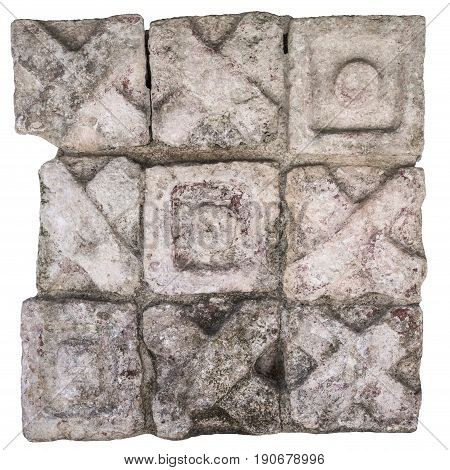 Maya stone block sculpture with X and O design like tic tac toe game at ruins of Chichen Itza isolated on white background