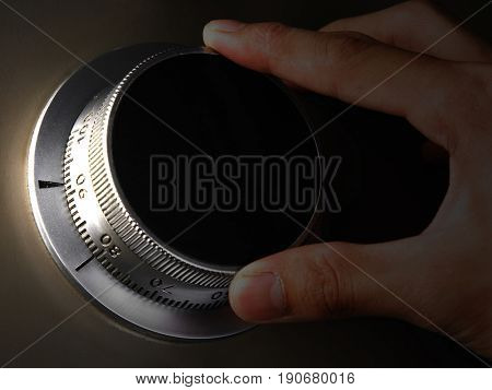 Close up image of hand turning a safety knob