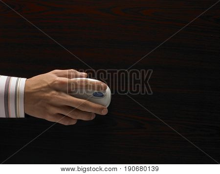 A hand using computer mouse