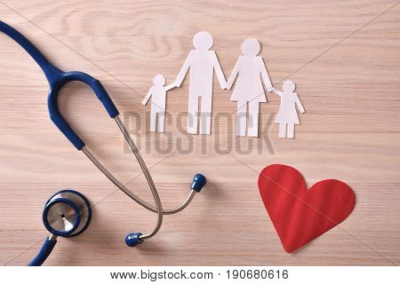 Concept Family Medicine With Ostetoscope And Cut On Wood Top