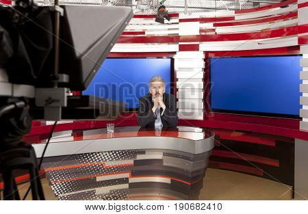 A television anchorman at studio during live broadcasting