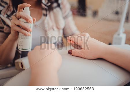 female hands applying hand cream. Hand care in the beauty salon poster