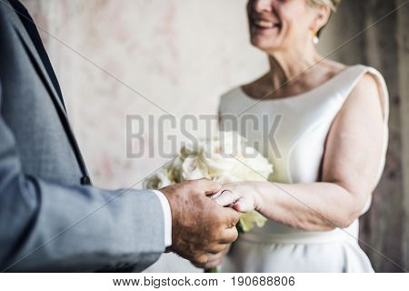 Senior Couple with Flower Bouqet