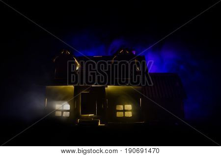 Old House With A Ghost In The Moonlit Night Or Abandoned Haunted Horror House In Fog. Old Mystic Vil