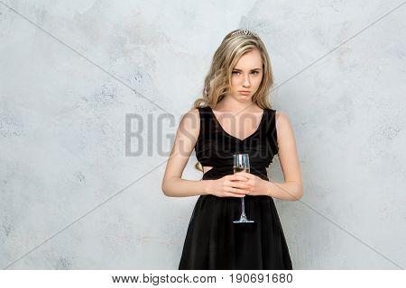 Young female party celeration isolated on white background sad