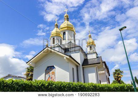 Ukrainian Church of the Virgin Dormition against the blue sky. France, Lourdes