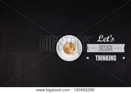 Designthinking concept. Cup of coffee on blackboard. Copyspase in left side.