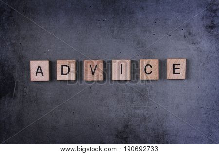 Advice word image with square wooden letters