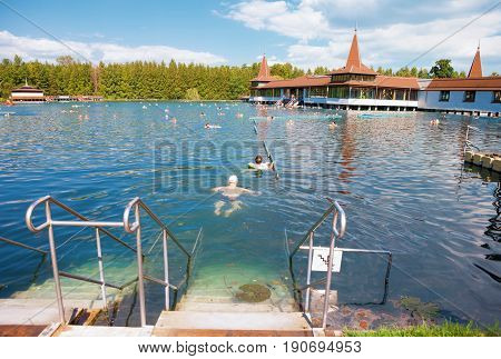 HEVIZ HUNGARY - 26 May 2017: Bathers swimming in Heviz Thermal Lake the 2nd largest natural thermal lake in the world in Hungary