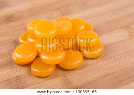 Butterscotch Hard Candies On A Wood Background