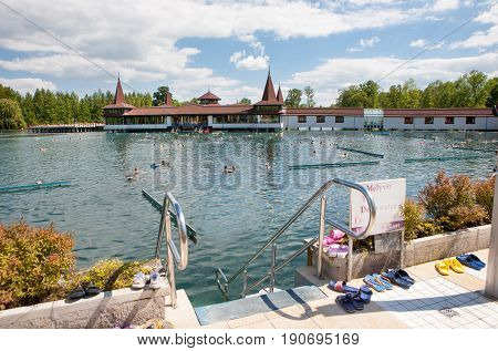 Heviz Hungary - May 26 2017: Heviz spa with bathers at spring. Lake Heviz is the 2nd largest natural thermal lake in the world.