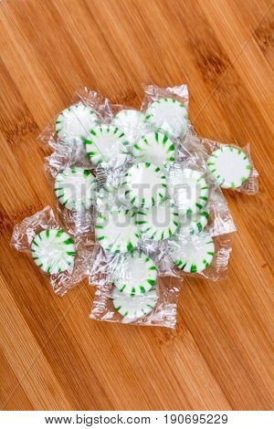 Mint Hard Candies On A Wood Background
