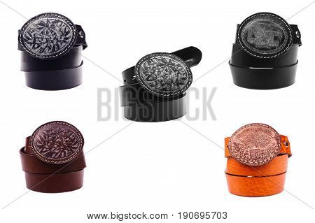 Set Belt male leather.The fashionable accessory is twisted on a white background.With a metal buckle.Natural animal skin.