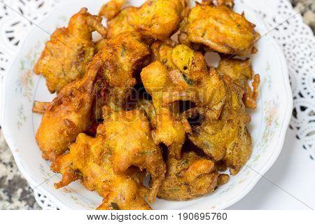 Crispy onion pakora or bhajis or pakoda popular fried Indian snack for Ramadan iftar