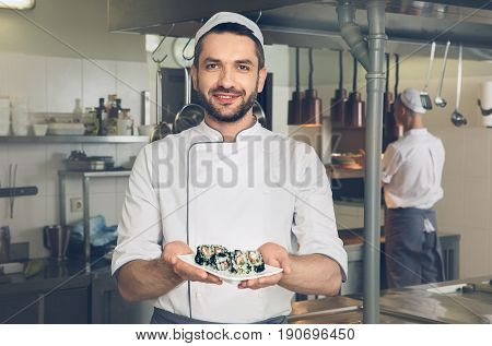 Male japanese restaurant chef cooking in the kitchen dish cooked