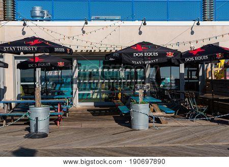 Asbury Park NJ USA -- June 11 2017 -- A restaurant / bar on the Asbury Park boardwalk on a summer morning. Editorial Use Only.