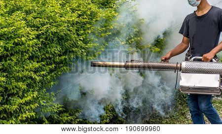 People fogging DDT spray kill mosquito for control Malaria Encephalitis Dengue and Zika in village at Bangkok Thailand.