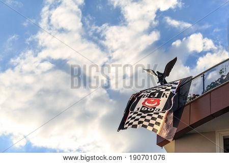 At Marmaris, Mugla, Turkey - June 6, 2017: Besiktas turkish sport team flag with eagle symbol of the team on balcony after championship of the team in Marmaris Mugla Turkey