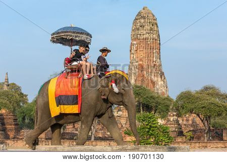 Ayutthaya, Thailand - March 2, 2017: Tourists on the elephants ride tour of the ancient city in Ayutthaya, Thailand