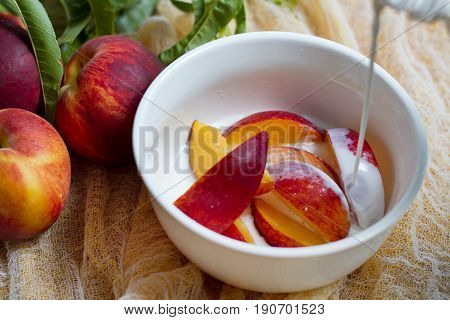 bowl of fresh local peaches with cream