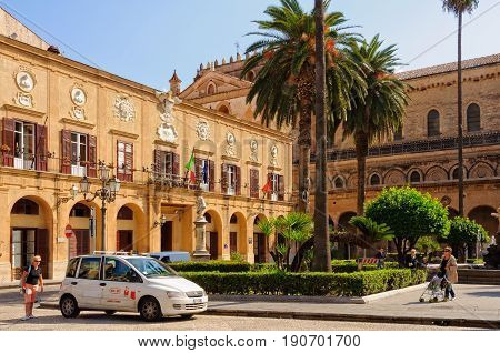 A taxi is waiting for passengers in front of the Town Hall and Cathedral on the Vittorio Emanuele Square - Monreale, Sicily, Italy, 21 October 2011
