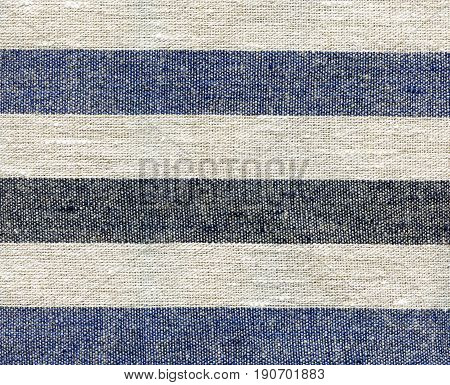 Blue beige gray stripe pattern on linen fabric. White fabric texture with stripes. Striped cotton texture