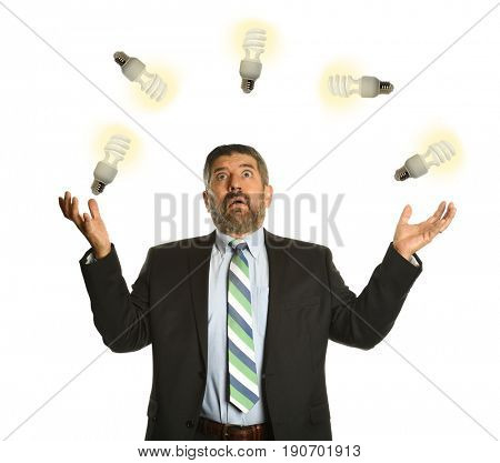Businessman Juggling with light bulbs isolated on a white background