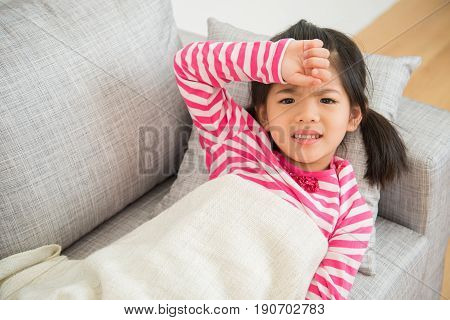 Girl With Illness And Hand On Her Head