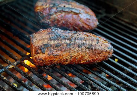 Beef steaks on the grill with flames Steak roasted on fire