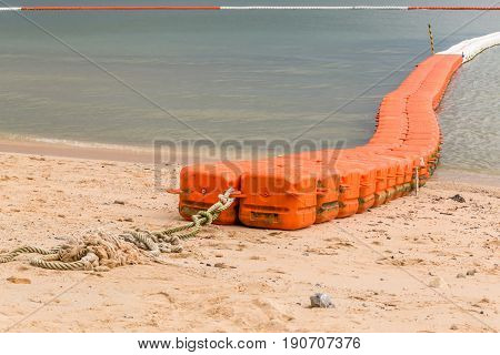 Close up line of sea buoys fasten on sea beach marine equipment for marking safety zone.