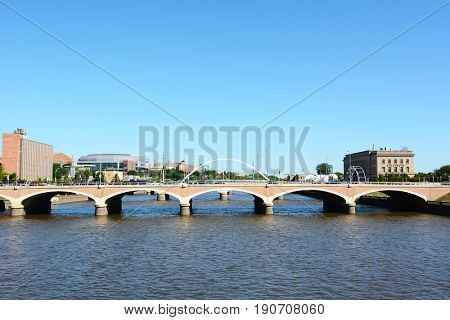 DES MOINES, IOWA - AUGUST 20, 2015: Bridge over the Des Moines River. The Wells Fargo Arena is visible in the background.