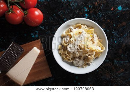 Italian chicken alfredo pappardelle pasta with cheese and cream sauce