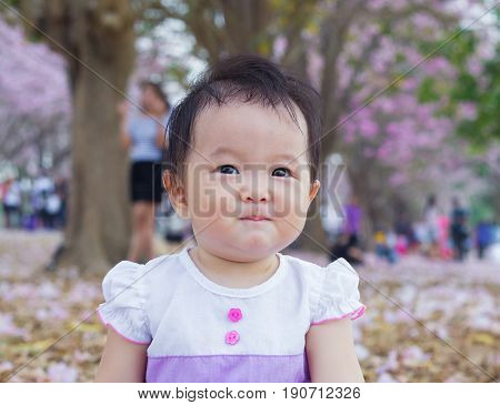 cute baby happy in garden and smile