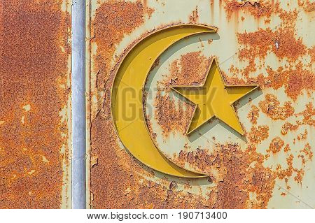 old islam symbol on rusty metal close up