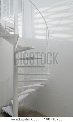 White spiral staircase in modern room. interior design