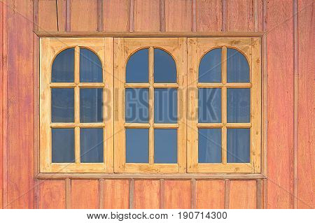 wooden window and glass on wooden wall
