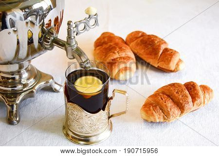 Tea from a samovar with sweet pastries. Selective focus