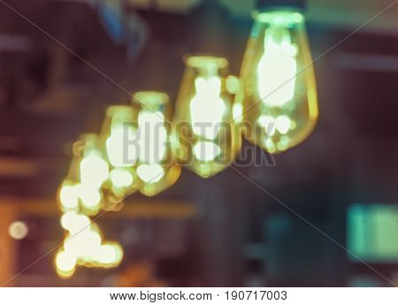Blurred images of yellow bulbs. Abstract for background image