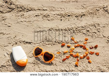 Word And Shape Of Sun, Sunglasses With Sun Lotion, Copy Space For Text On Sand At Beach